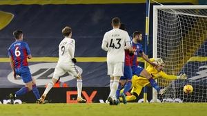 Patrick Bamford beats Vicente Guaita of Crystal Palace to score their teams second goal