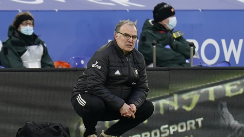 Leeds United manager Marcelo Bielsa crouches on the touchline