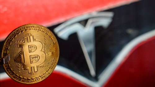 Bitcoin seeing big gains after electric carmaker Tesla said it bought $1.5 billion in bitcoin and would accept the currency as payment