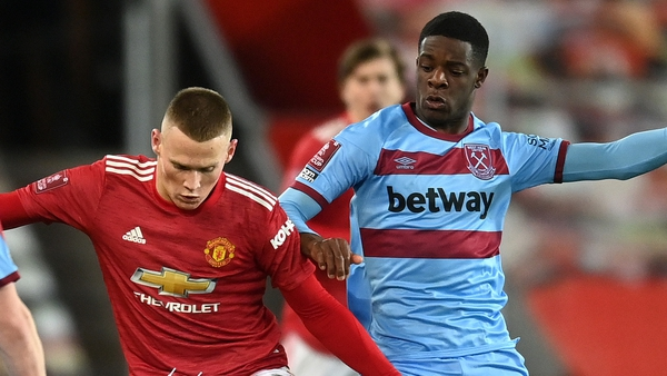 Scott McTominay battles with Mipo Odubeko at Old Trafford