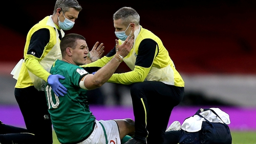 Johnny Sexton is attended to by the Irish rugby medical team at Cardiff