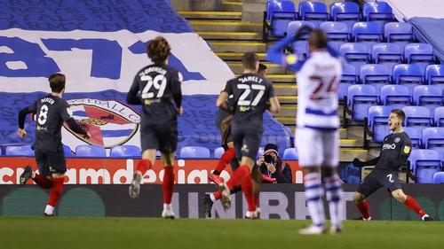 Brentford's Josh Dasilva (hidden) celebrates with Sergi Canos after scoring his team's second goal against Reading