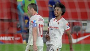 Ex-Barcelona midfielder Ivan Rakitic (L) celebrates with Jules Kounde