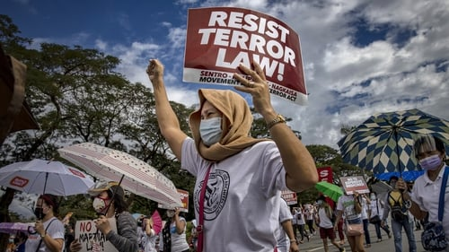 Filipinos take part in a protest over a new anti-terrorism law in November 2020