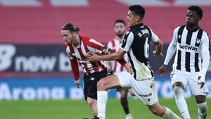 Iker Muniain of Athletic Bilbao is tackled by Oscar Duarte of Levante