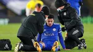 Leicester City's James Justin receives treatment