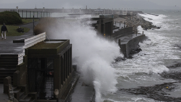 Waves crash over the walls of Dún Laoghaire's East Pier this afternoon in Dublin (Pics: Rolling News)