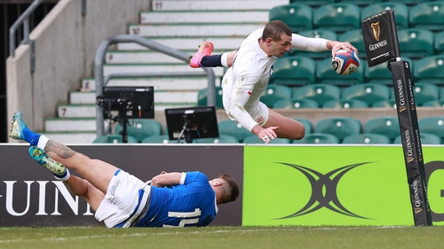 Jonny May dives over Luca Sperandio of Italy to score England's third try