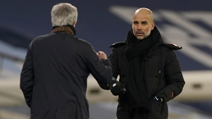 Manchester City manager Pep Guardiola (R) greets Spurs boss Jose Mourinho after the game