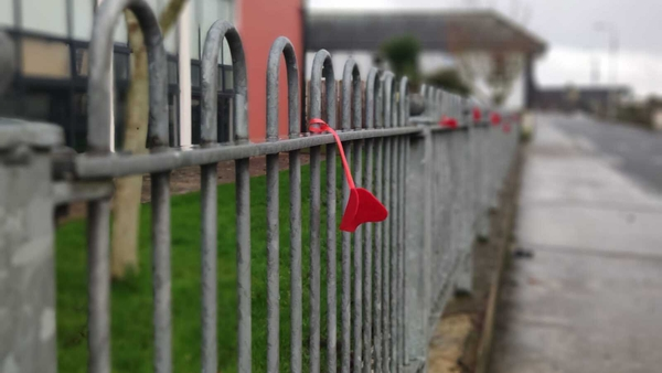 Hundreds of red felt hearts were carefully placed on trees and on railings around the town