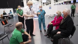 British Prime Minister Boris Johnson speaks to patients and staff at a vaccination centre at Ashton Gate stadium in Bristol