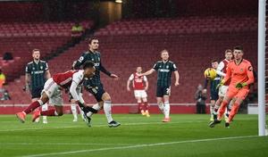 Aubameyang dives to head home his third goal.