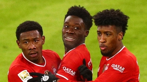 Alphonso Davies (C) celebrates his equaliser with David Alaba (L) and Kingsley Coma