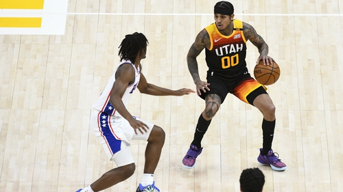 Jordan Clarkson of the Utah Jazz attempts to drive around Tyrese Maxey