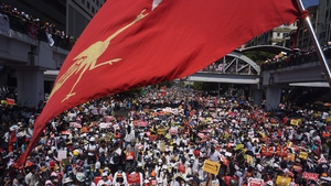 Protesters block a major road during a demonstration against the military coup in Yangon