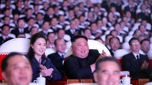 A photo released by the official North Korean Central News Agency Leader of North Korea Kim Jong-un (C-R) and his wife Ri Sol-ju together with members of the Party