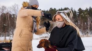 A hairdresser treats a client on the frozen lake Babelitis in Riga, Latvia