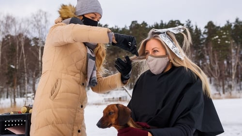 A hairdresser treats a client on the frozen lake Babelitis in Riga, Latvia