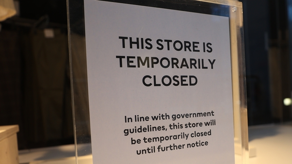 A sign in the window of a store at the Victoria Square shopping complex in Belfast