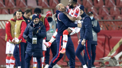 Red Star's Guelor Kanga (up) celebrates with his coach Dejan Stankovic