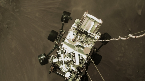 A shot from a camera on the rover's 'jetpack' captures it in midair, just before touchdown (Images: NASA)