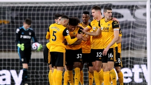 Wolves players celebrate after Leeds United goalkeeper Illan Meslier scores an own goal