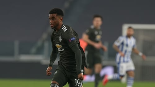 Amad Diallo in action against Real Sociedad on his debut with Harry Maguire watching on in the background