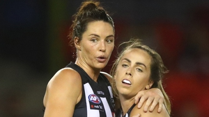 Collingwood's Sharni Norder and Aishling Sheridan celebrate after winning the round four AFLW match