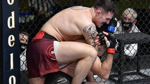 Tom Aspinall secures a rear choke submission against Andrei Arlovski