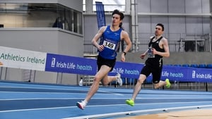 Cian McPhillips of Longford AC, left, leading Mark English out on the final lap of the Men's 800m