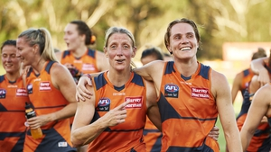 Cora Staunton celebrates victory with team-mate Pepa Randall