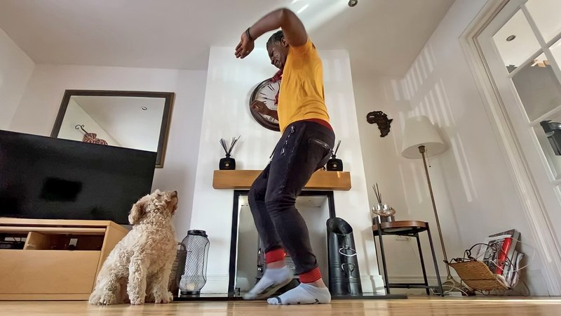 Cuthbert Tura Arutura and his dog Bella during an online dance class