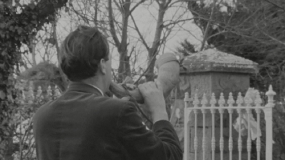 Man blowing ceremonial horn, Ballingrane, Co. Limerick (1966)