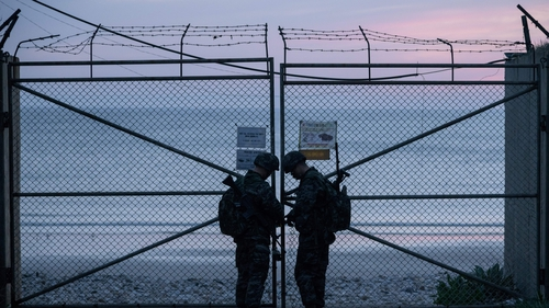 South Korean soldiers lock the entrance to a beach near the 'northern limit line' sea boundary with North Korea (file image)