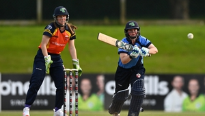 Laura Delany of Typhoons plays a shot watched by Shauna Kavanagh of Scorchers during the 2020 Series