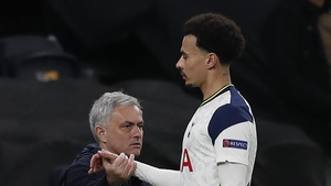 Dele Alli (R) shakes hands with Jose Mourinho after coming off
