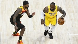 LeBron James of the Los Angeles Lakers drives into Royce O'Neale of Utah Jazz