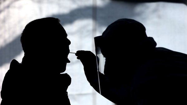 A health worker worker carries out a test for Covid-19 in Naumburg, Germany