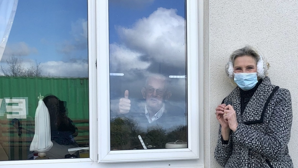Irene Winters has regular window visits with her father at his nursing home