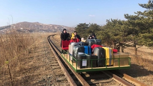 The trolley was pushed across the border (Pic: Russian Foreign Ministry on Facebook)