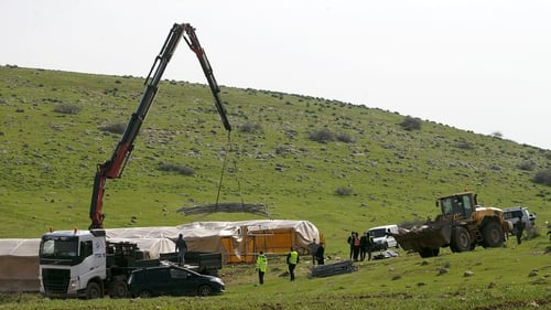An Israeli bulldozer during demolition of a Bedouin encampment in the north of the occupied West Bank