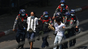 Police detain protesters in Yangon