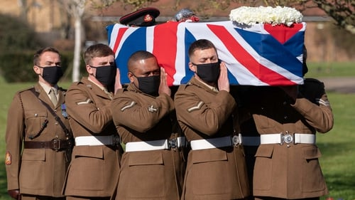 Soldiers from the Yorkshire Regiment carry the coffin into Bedford Crematorium