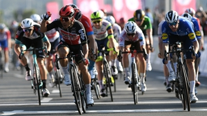 Caleb Ewan celebrates edging out Sam Bennett on the sprint to the line in Abu Dhabi