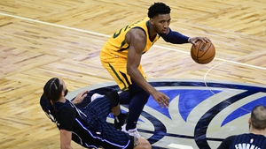 Donovan Mitchell dribbles the ball as he is fouled by Orlando Magic's Michael Carter-William