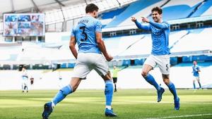 Ruben Dias celebrates with John Stones after Man City's opener against West Ham