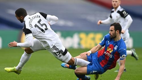 Fulham's uben Loftus-Cheek is fouled by Palace midfielder Luka Milivojevic