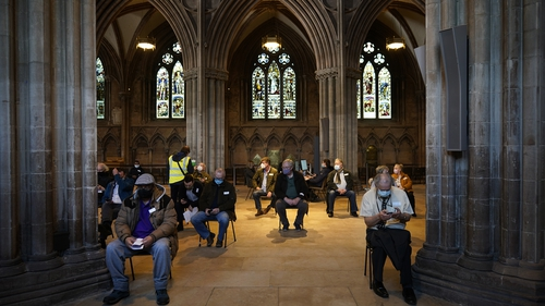 People receive their Covid-19 jab at a vaccine centre, Lichfield Cathedral, in Staffordshire, England