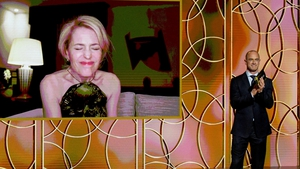 Gillian Anderson pulls a face as she wins a Golden Globe