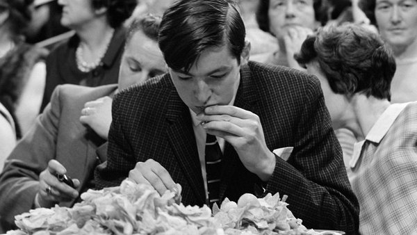 A participant munches on some crisps during an eating contest on the Late Late Show in February 1969. Photo: Roy Bedell/RTÉ Stills Library